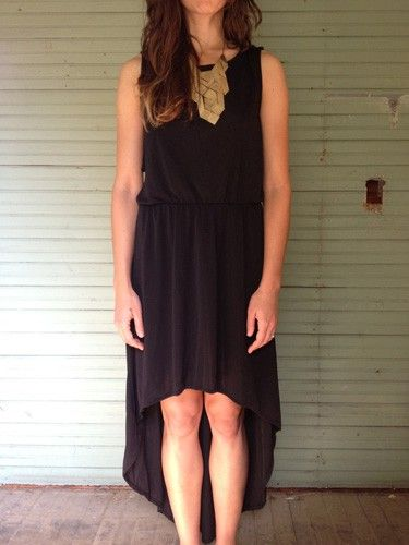 black curved hem dress with winged open back