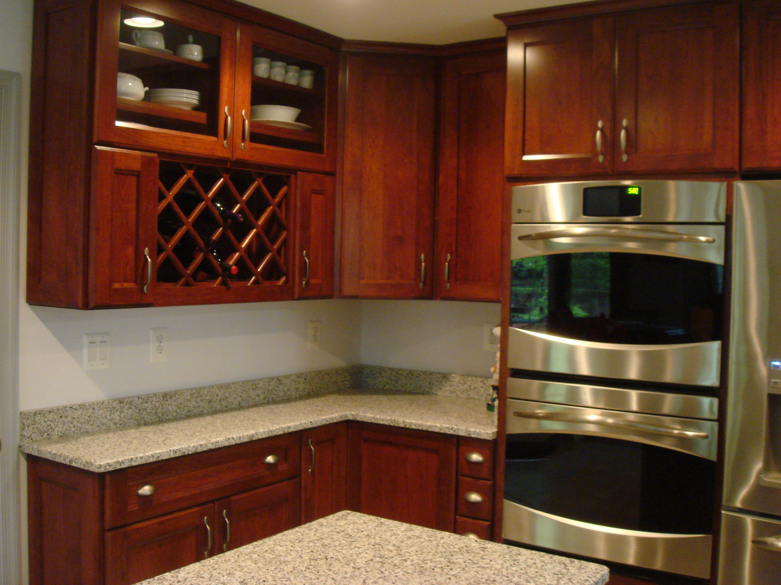 Kitchen Island Knee Wall main cabinetry: cord's custom cherry in autumn spice. tops