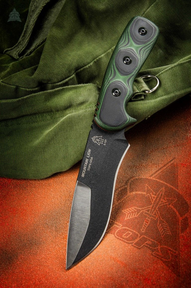 "Mountain Lion  O/A Length: 10 3/4"" Blade Length: 5 1/2"" Thickness: 1/4"" Steel: 1095 High Carb. Handle: Green/Black G-10 Color: Black Traction Coating Sheath: Nylon"