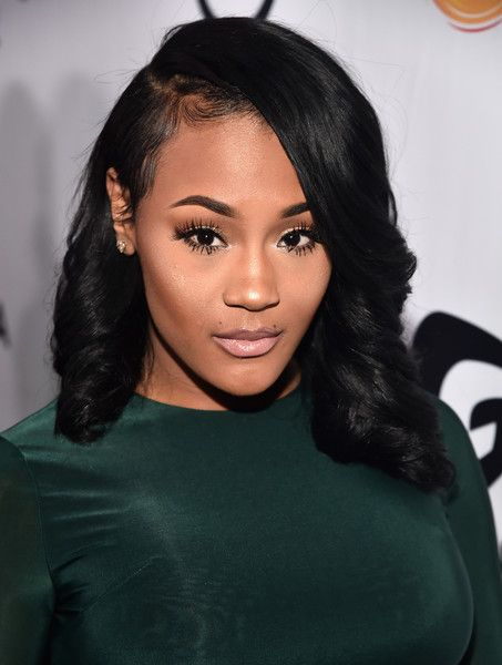 "Lira Galore""s side partied hairstyle"
