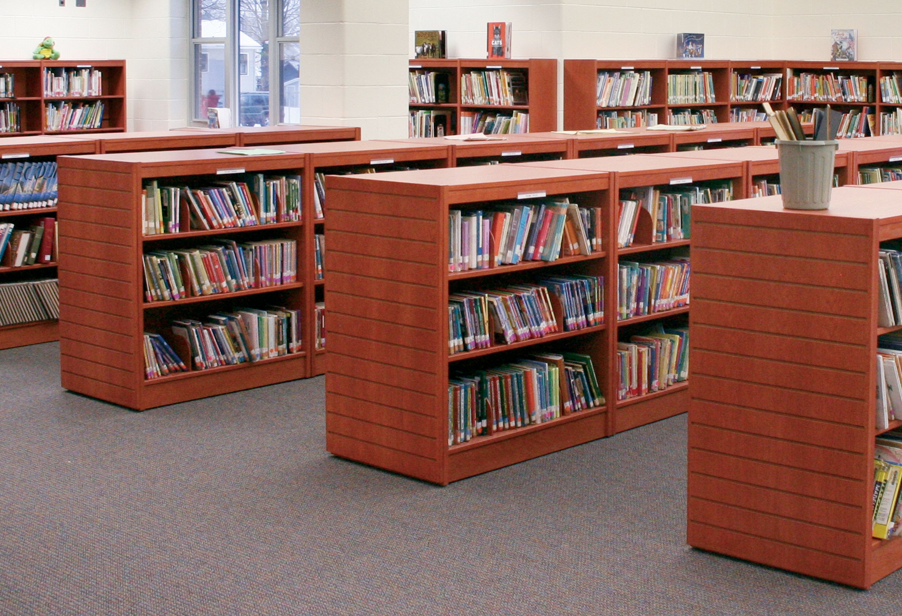 Bookmark double faced mobile shelving with stall end