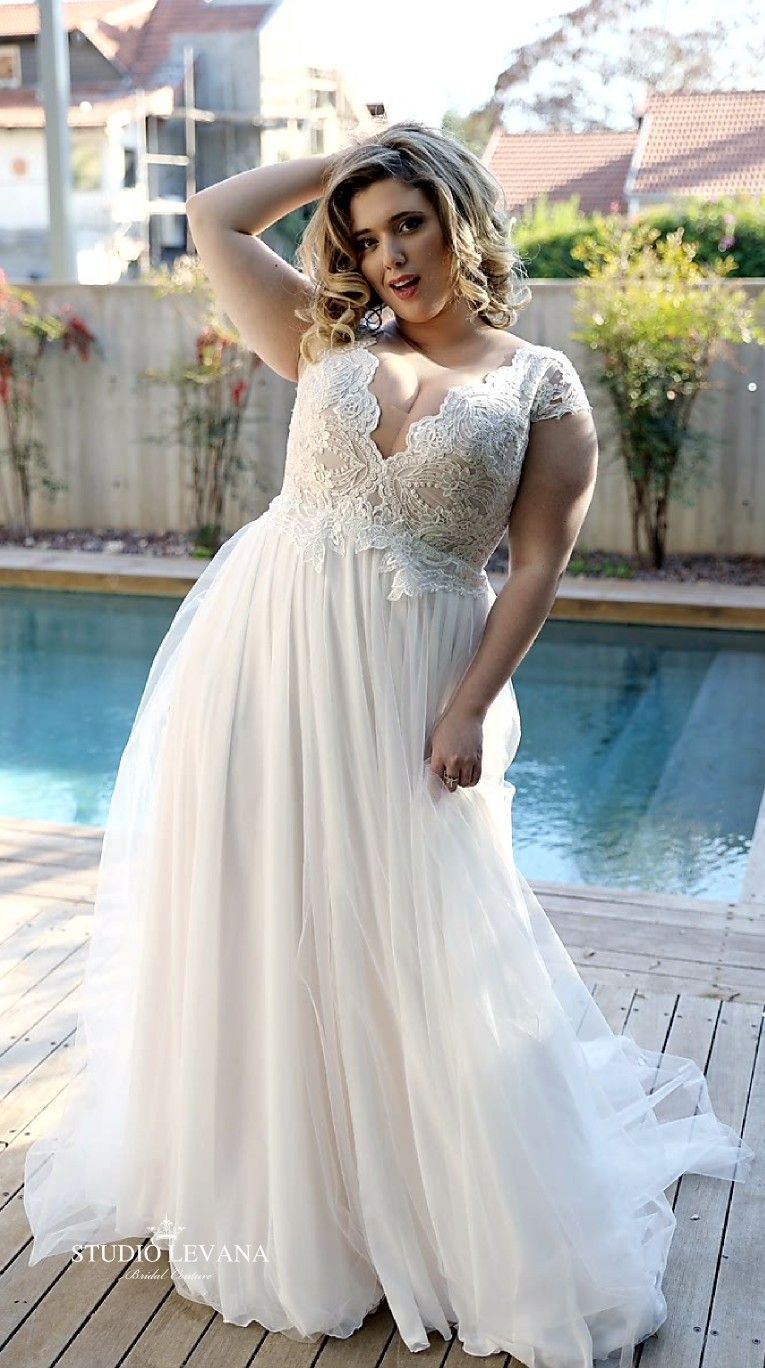 Cool unique plus size wedding dress with deep scalloped v