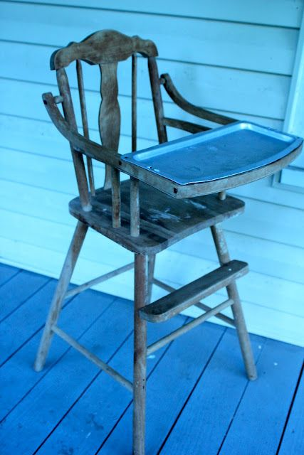 We don't need one of these but I absolutely loved the DIY makeover on this old wood highchair! Beautiful!
