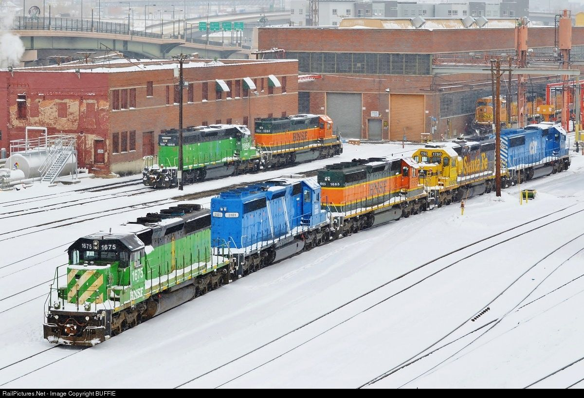 The snow covers a colorful assortment of light power waiting at the Denver BNSF engine servicing facility.