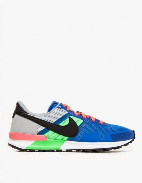 The 30th anniversary update on the iconic Nike track shoe with modern detailing for breathability, comfort, and all-purpose everyday wear. Features vibrant  royal blue and poison green mesh upper, perforated tongue with branding, perforated heel liner, an