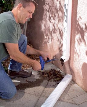 Use a plumber's snake to clean out leaves in your gutter.