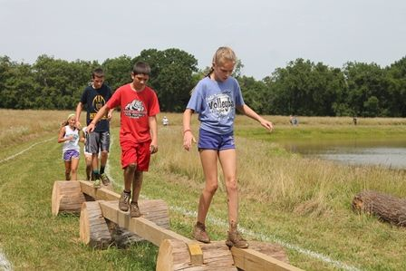 First annual SPLAT! event at Gans Creek Recreation Area in Columbia, MO. Here kids are being challenged to walk beams.