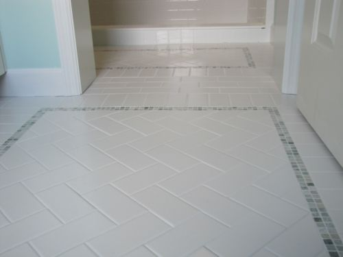 High Quality Herringbone Subway Tile Floor With A Pretty Mosaic Tile Border