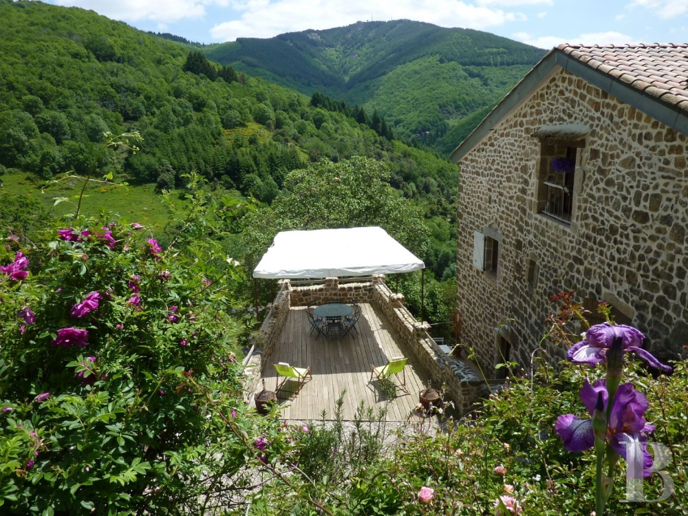 An old fortified farmhouse surrounded by nature in the