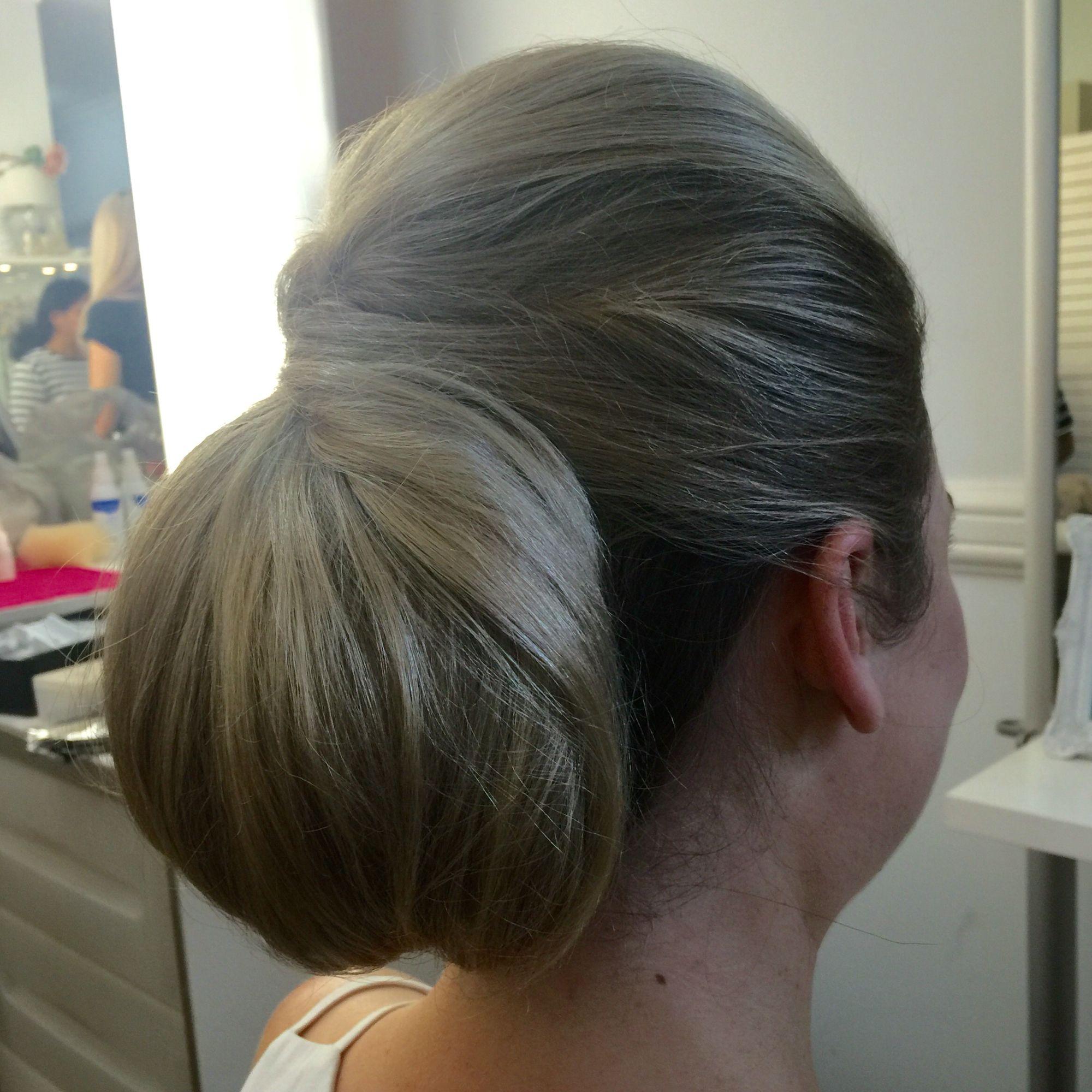 Classic clean bridal upstyle. Low bun using padding
