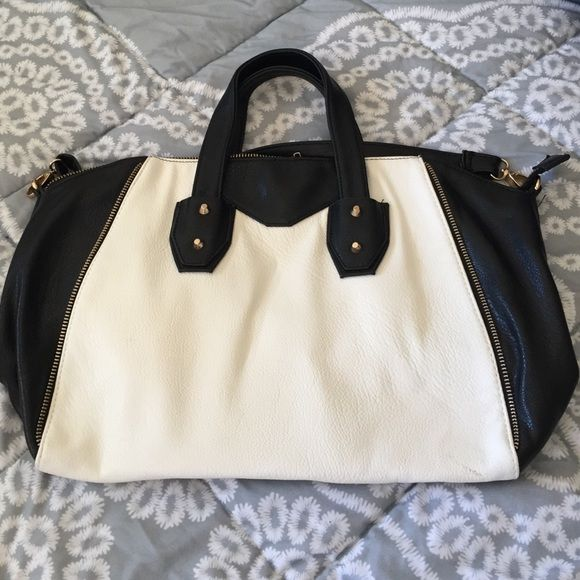 Large monochrome handbag Black and white bag from Nordstrom. Can fit a laptop and a couple of books. Comes with an over the shoulder attachment. Small stain on white part Nordstrom Bags