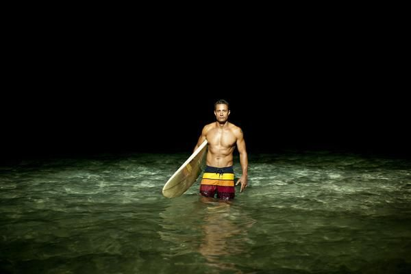 Photographer |  Peter Beavis 00143008 | Male Surfer Standing In The Sea At Night With His Surfboard.