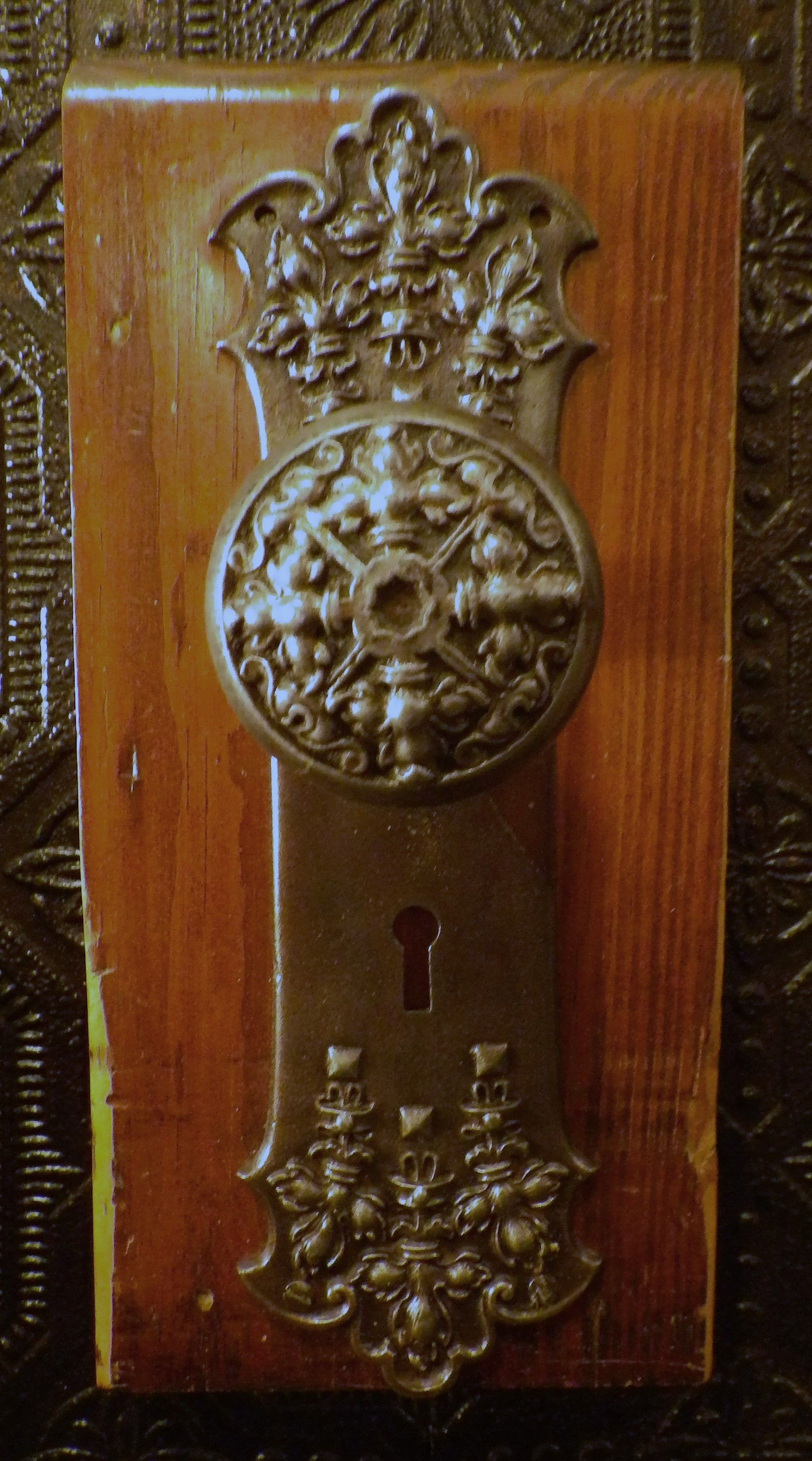 heavy cast iron antique door knob and plate decorated with fleur de ...