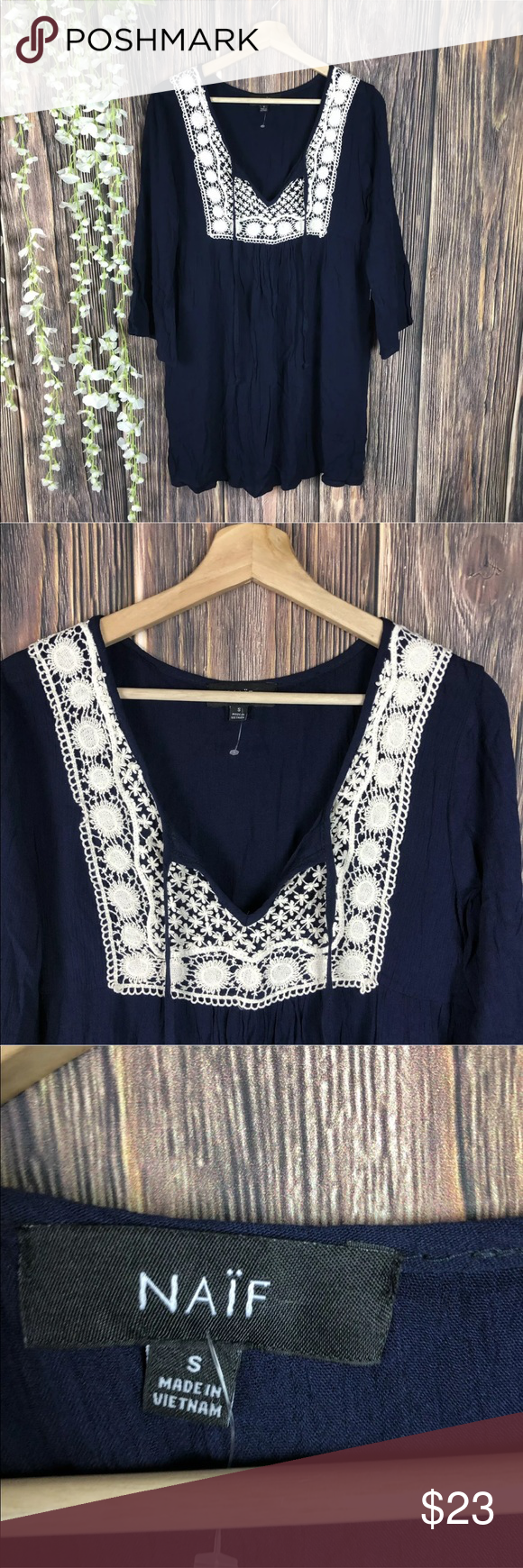 Naïf dress bell sleeve blue cream crochet bell slv Naïf  New with tags  Women's size small  Navy blue dress  Cream crochet/embroidery details fron…