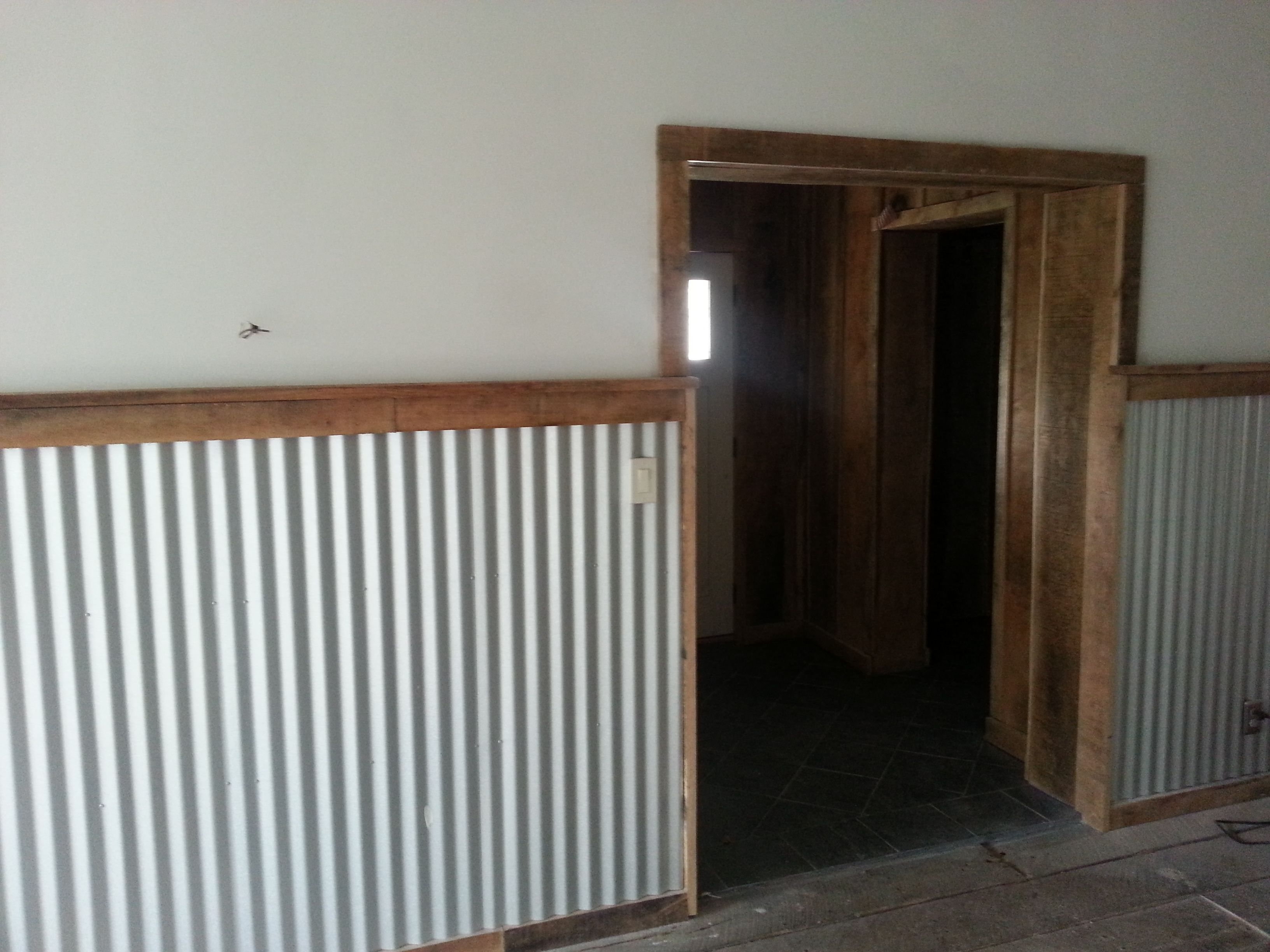 Rough cut trim and corrugated steel barn rehab for Metal barn over basement