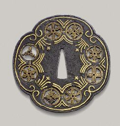 Namban tsuba with Mon motives , one a Christian cross