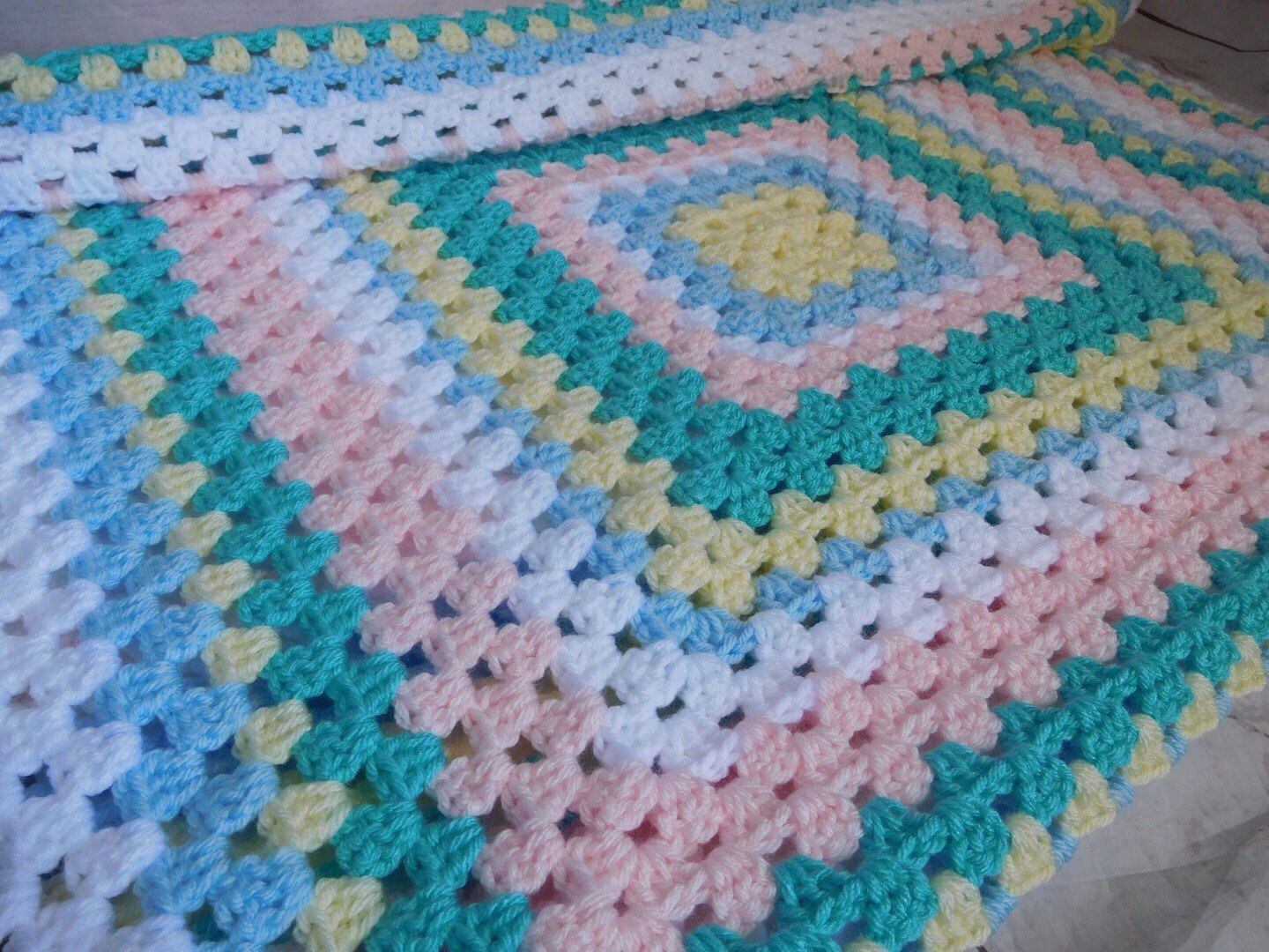 Pastel color granny square baby blanket. This is a very special handmade crochet baby blanket. This baby afghan will make a wonderful baby shower gift. This blanket would make a lovely addition to your baby nursery decor. Perfect also, for travel, strollers, prams, cribs, tummy time and photo props