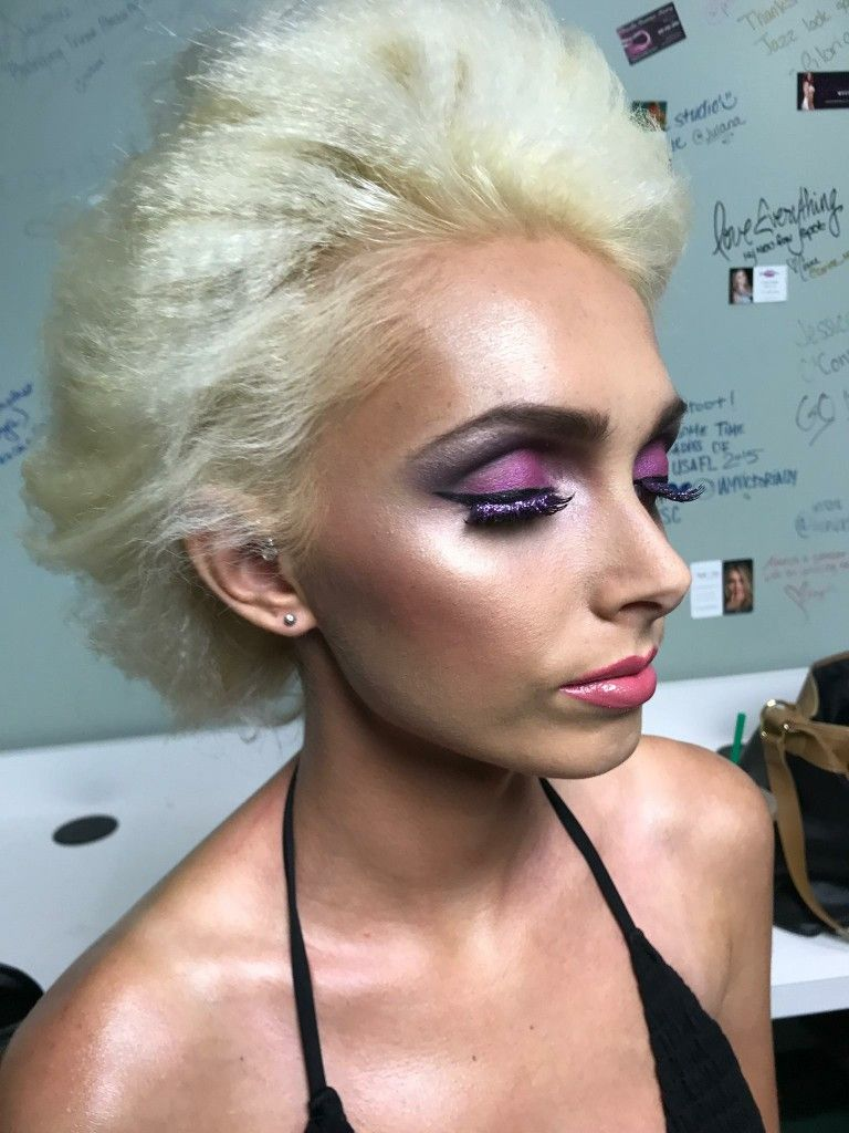 Purple eyeshadow and flawless makeup by makeup artist