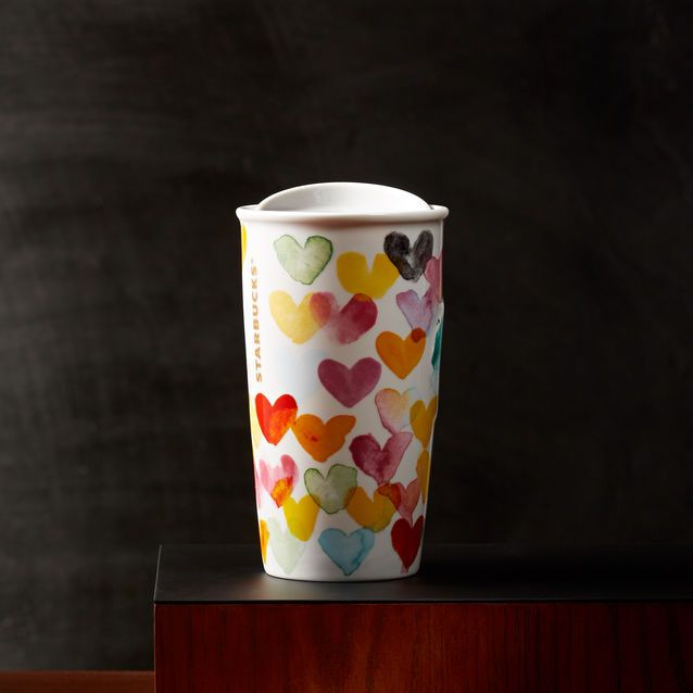 A double-walled ceramic mug featuring a heart of every hue in watercolour style.