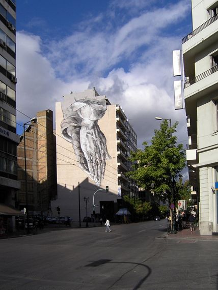 """Art and Public Space, Painting for the Blind-sided buildings of Athens"" - a Program of Fine Arts in collaboration with the ministry from 2010 to 2011. Proposal of P.Tsakonas, reference design of A. Durer, 1506. Piraeus Street. Mural painting by Manolis Anastasakos and Kretsis crew, August-September 2011."