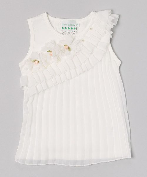 Boasting an intricately knit detail in back, pleated front and pearl bead accents, this darling tank is unique and sweet. Soft cotton makes it easy to wear, and simple care instructions have it washed in a jiff.