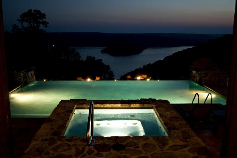 sunset view of the infinity pool and Table Rock lake at The Villa at Integrity Hills