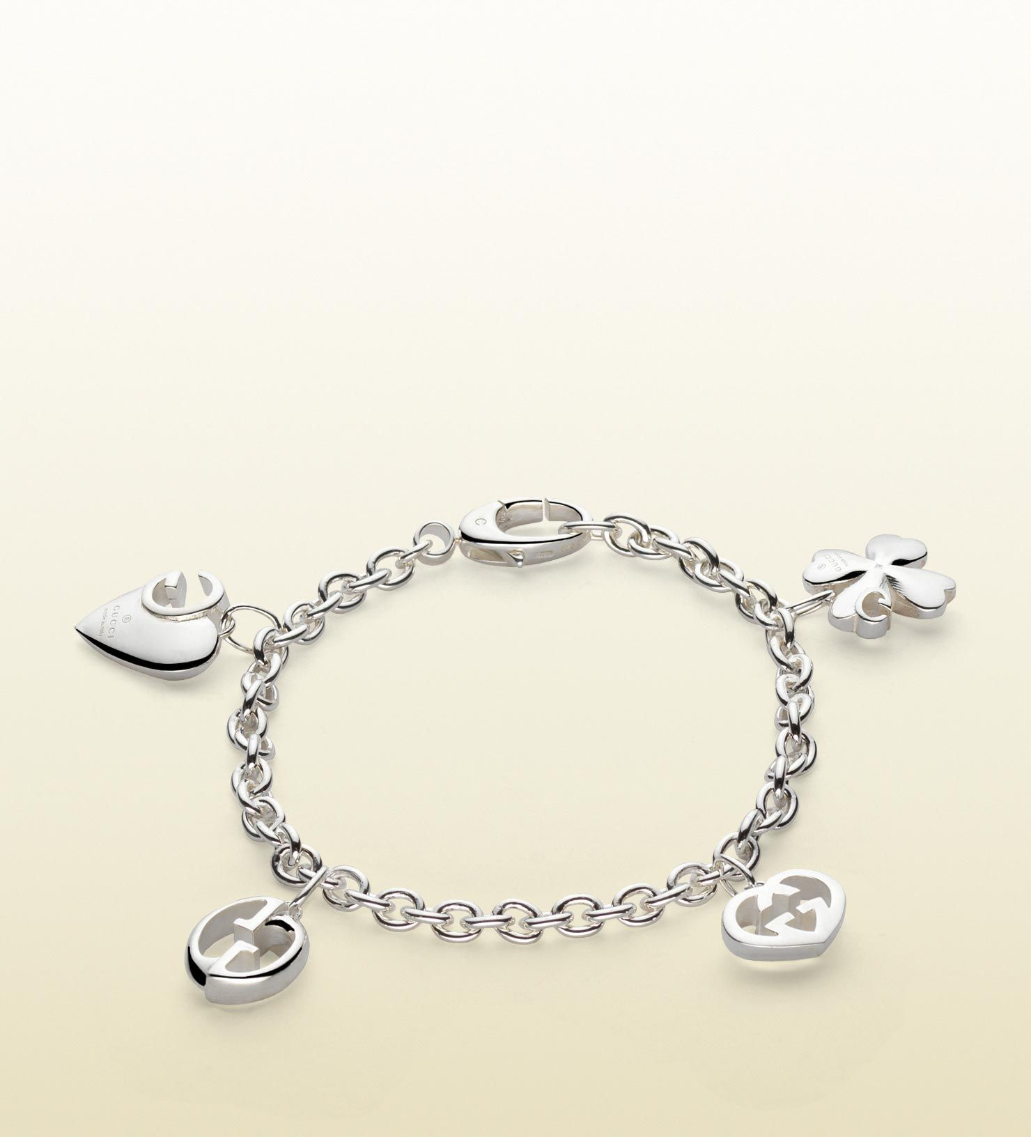 Sterling silver Gucci bracelet with charms