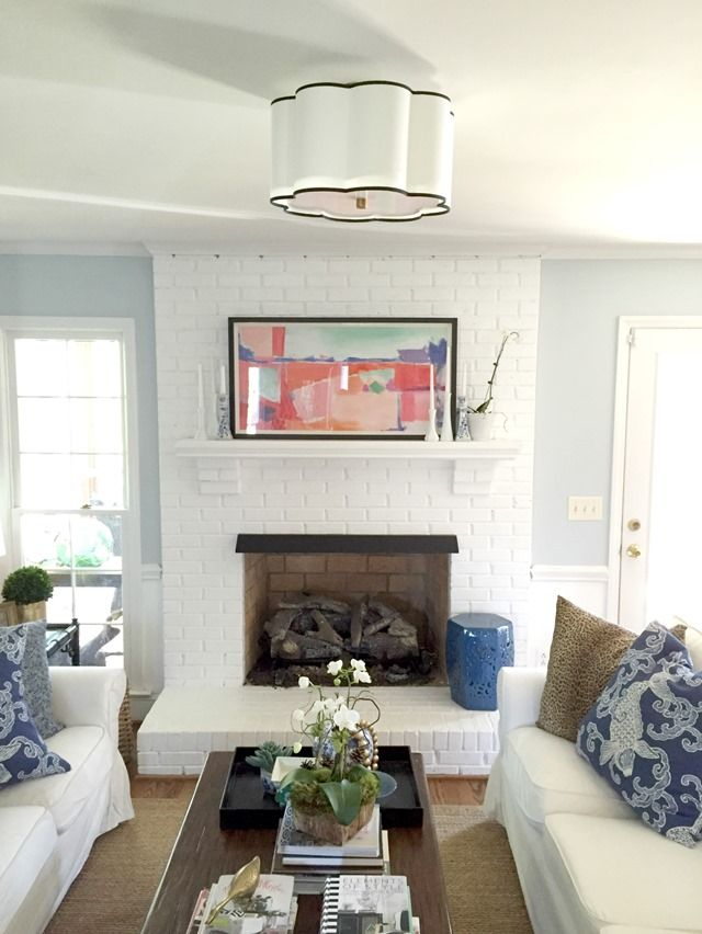 Light Blue Living Room Scalloped Flush Mount Pendant And White Abstract Artwork Painted Brick Fireplace