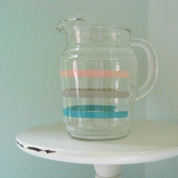 Vintage glass pitcher. Same shape as the pitchers Anchor Hocking made. I have one: different pattern, same mold.