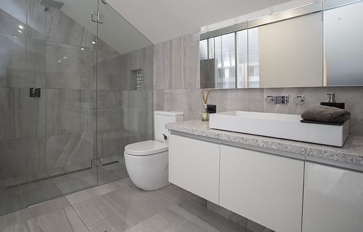 A Simple Colour Scheme Walk In Shower And Large Square Tiles Turned A Cramped Ensuite Into A S Minimalist Bathroom Bathroom Renovation Designs Bathroom Design