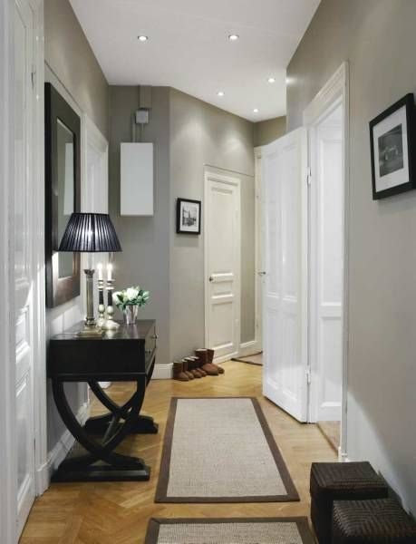Grey walls white doors black/brown frames with mirror and table ...