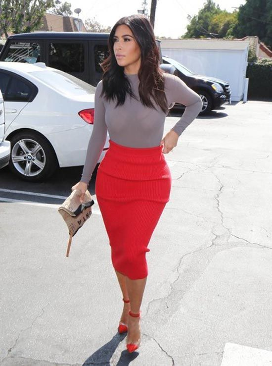 Kim Kardashian Pumps , Kim Kardashian teamed her head,turning shopping  outfit with a pair of red PVC cap,toe pumps.