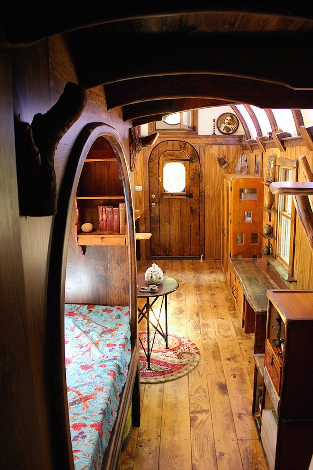A 204 square feet tiny house with hand carved interior woodwork throughout in kerhonkson new york built by the unkown craftsman