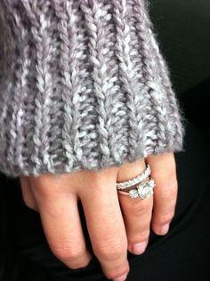 Three Stone Engagement Ring Sits Inside Wedding Band