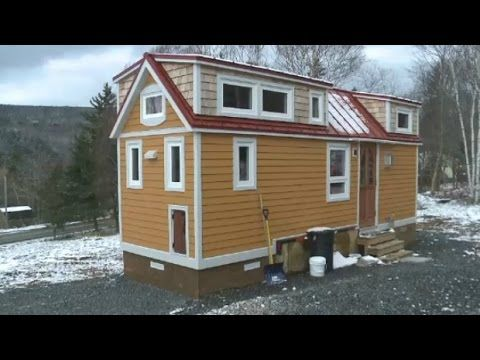 Couple Living Large In Tiny Home That Includes Dog Elevator Youtube Little Houses On Wheels House On Wheels Tiny House