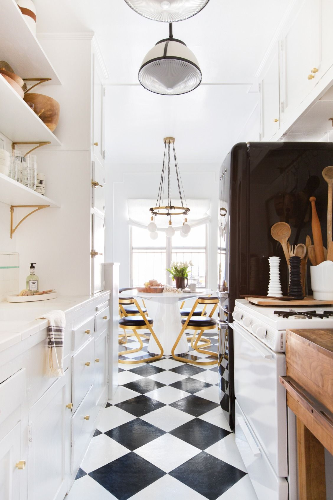 A Black White And Brass Studded Kitchen Black And White