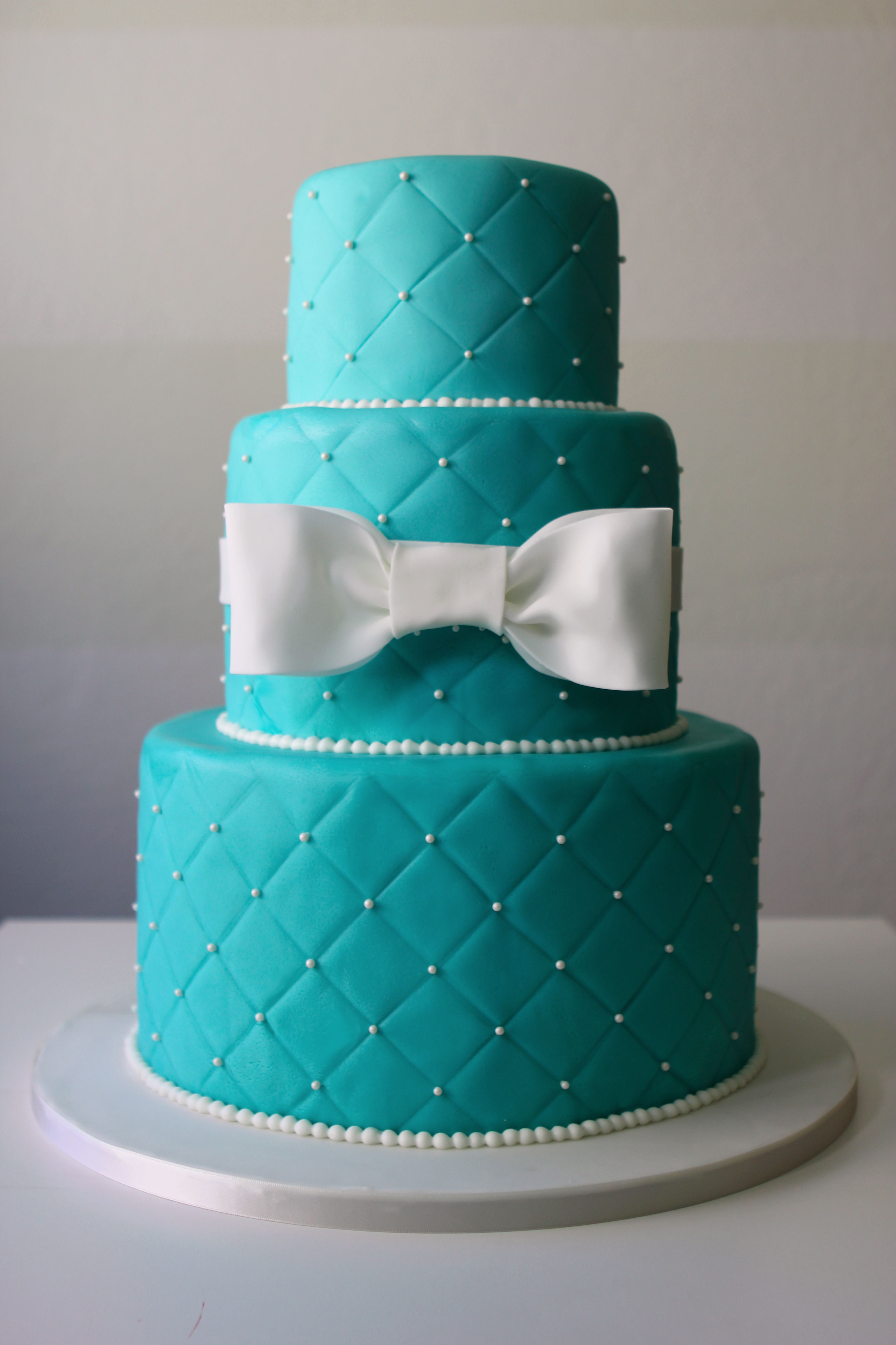 Tiffany Blue Wedding Cake With White Bow And Pearls