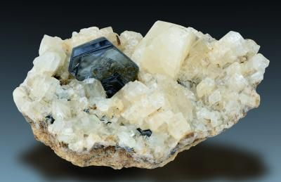 Hematite with Adularia - Fibbia, Tessin, Switzerland Size: 6.3 x 3.0 x 4.8 cm