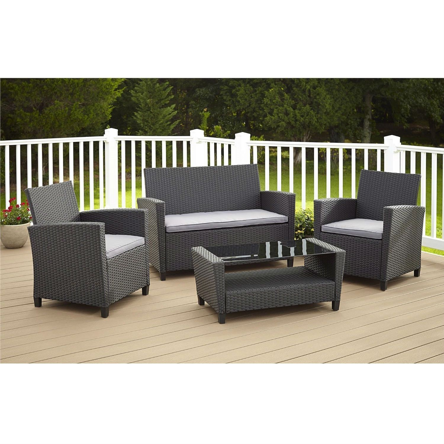This 4 Piece Outdoor Patio Furniture Set In Grey Resin Wicker And