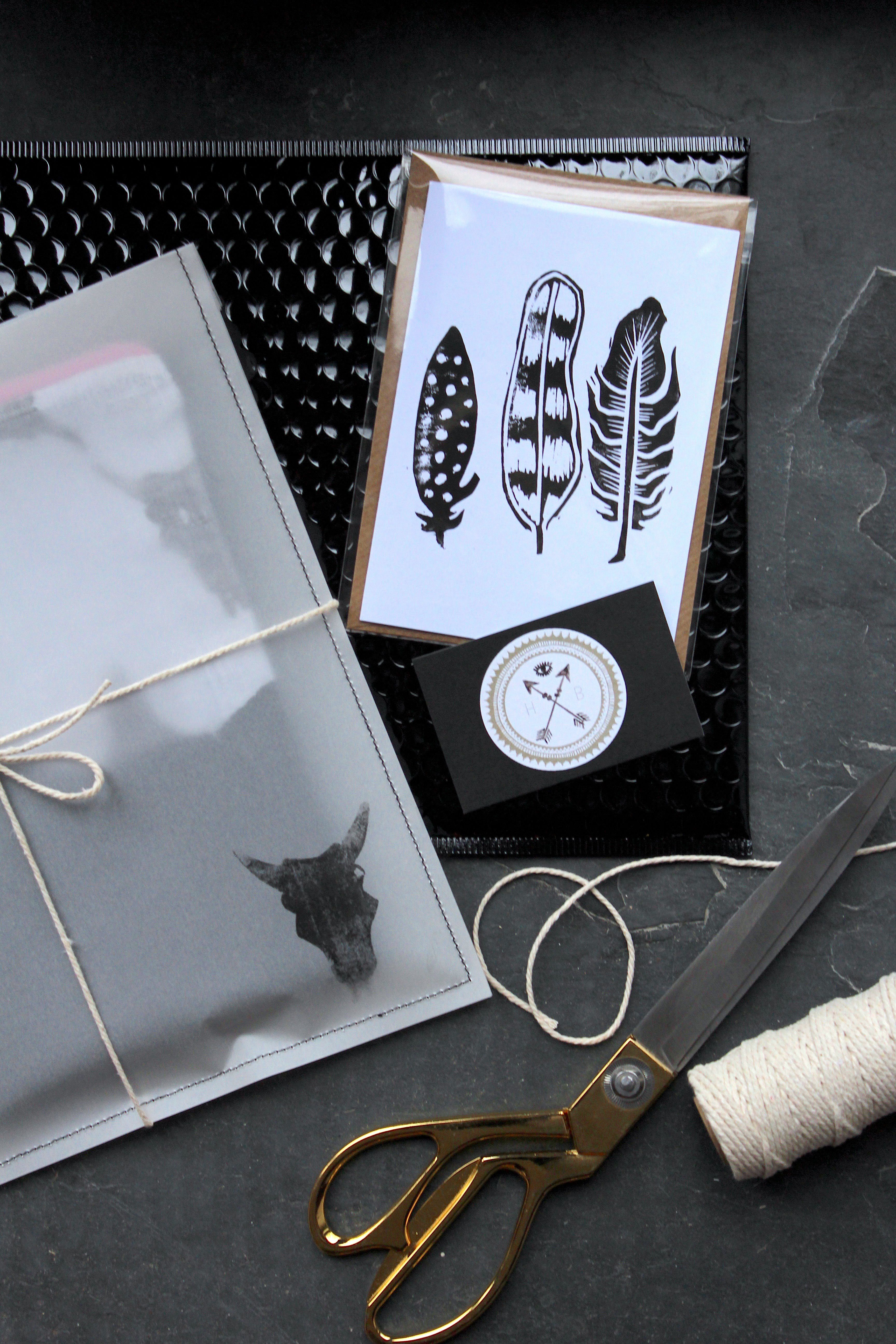 Pretty Packaging With Hand Stitched Vellum Sleeves And Glossy Black