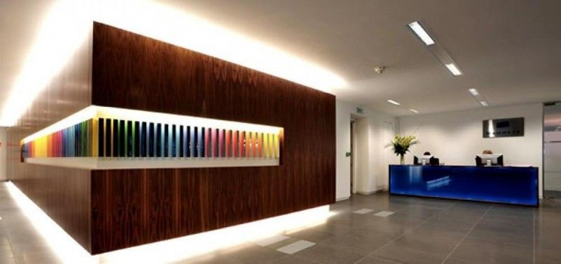 Office interior design stenham reception with lighting for Contemporary office design concepts