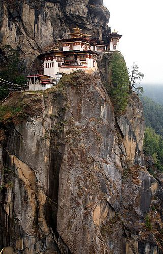 The Tigers Nest Buddhist monastery buildings (Bhutan) consist of four main temples and residential shelters designed by adapting to the rock (granite) ledges and eight caves. All the buildings are interconnected through steps and stairways made in rocks. There are a few rickety wooden bridges along the paths and stairways also to cross over. The temple at the highest level has a frieze of Buddha. Each building has a balcony, which provides lovely views of the scenic Paro valley down below.