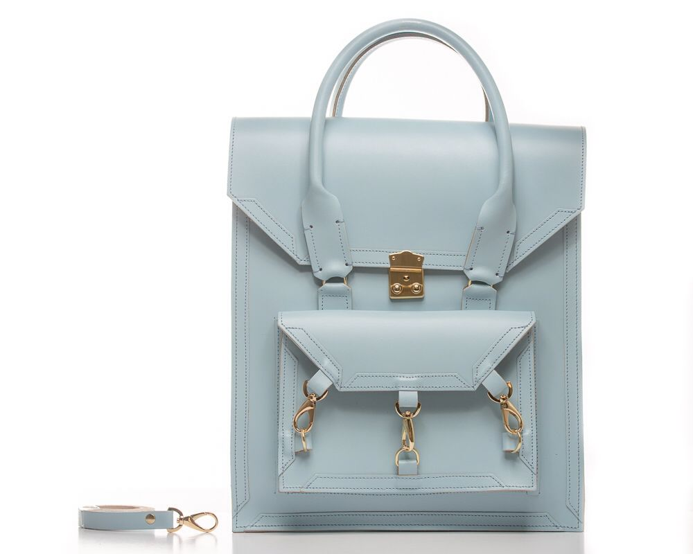 Blue Pelham tote bag can be worn across the body as a cross body bag with a detachable shoulders straps. The structured smooth sturdy cow leather comes with all gold-tone hardware the main front clutch lock its a Swiss-made lock, and with three trigger hooks and D ring hardware. The handle of the bag it's a rolled skinny handle with chunky stitches on both sides of the handle and leather pattern trimmings.  #bag #handbag #tote #blue