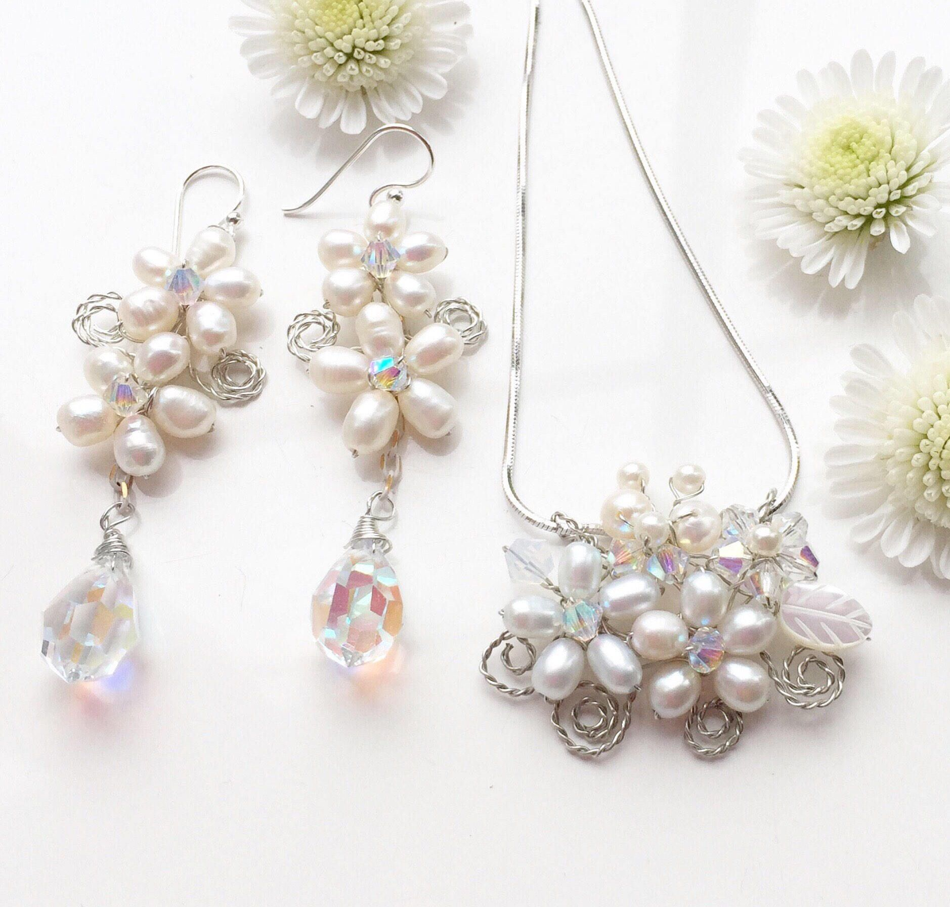 A personal favourite from my Etsy shop https://www.etsy.com/uk/listing/524659697/white-pearl-jewellery-pearl-floral
