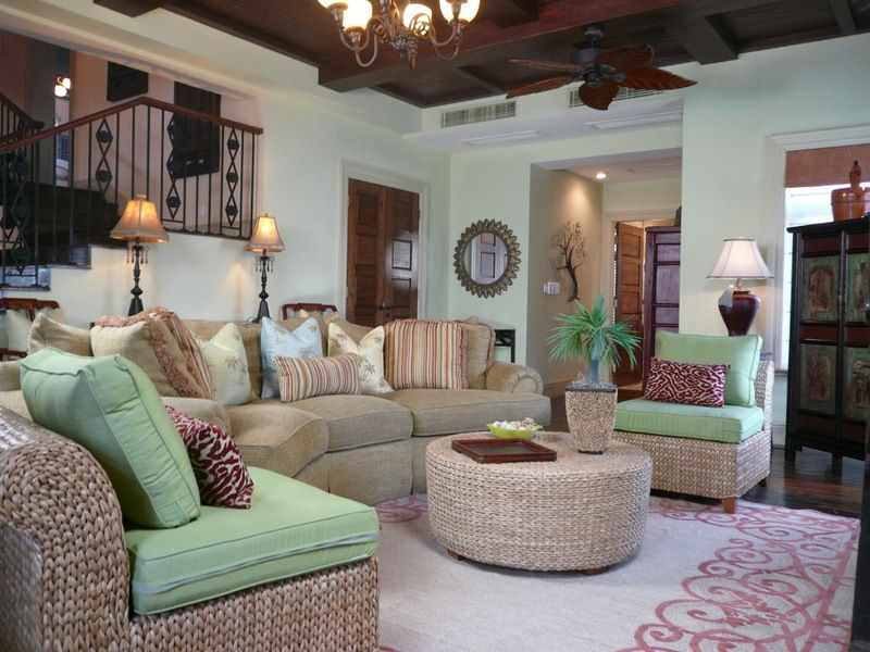 The living room helps set the mood for the basement with the cool greens and wicker furniture.  Notice on the round wicker table there is a brown antique Chinese tray,