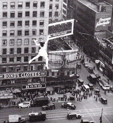 """Tiny Kline performs the """"Iron Jaw Slide For Life"""" over Times Square, 1935."""