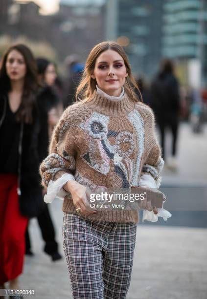 Olivia Palermo is seen wearing plaid pants, beige knit outside…
