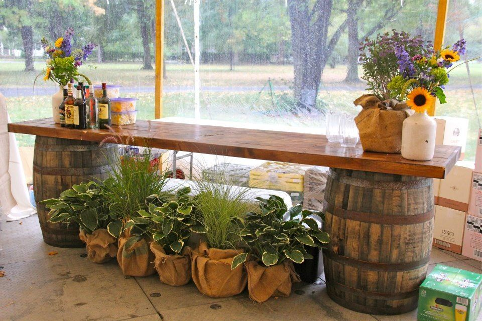 Like this for a bar idea at a wedding! The barrels you can but at Home Depot for $30 or less!