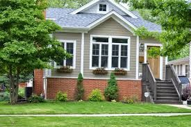 Green Siding With Red Brick Google Search Brick Exterior House Orange Brick Houses Red Brick House Exterior