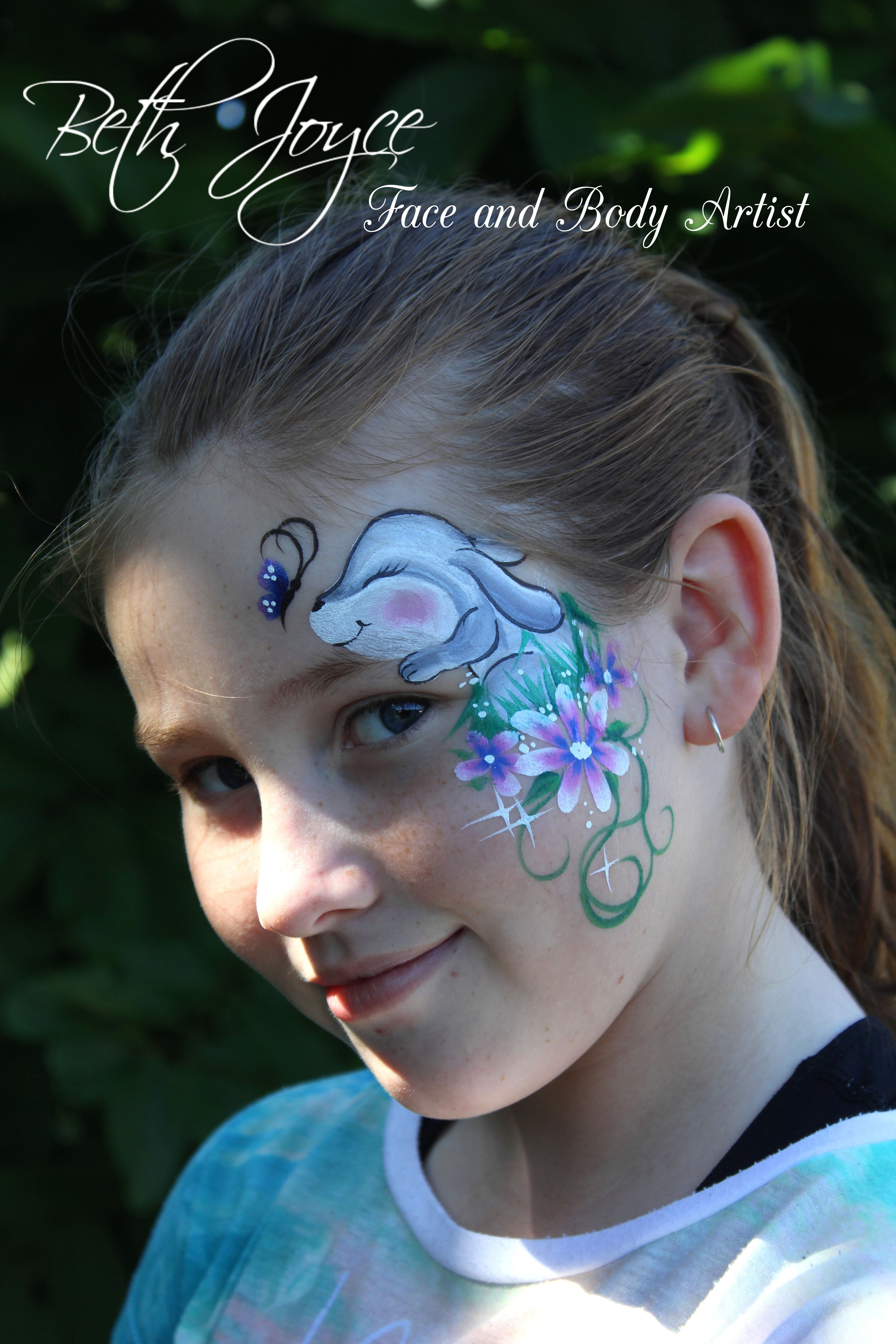 Cute Bunny Face Painting. It looks like the Butterfly is about to land on his nose :) Is this what the Easter Bunny is doing when he's not delivering all over the world? Faces and Bodies are my canvas!